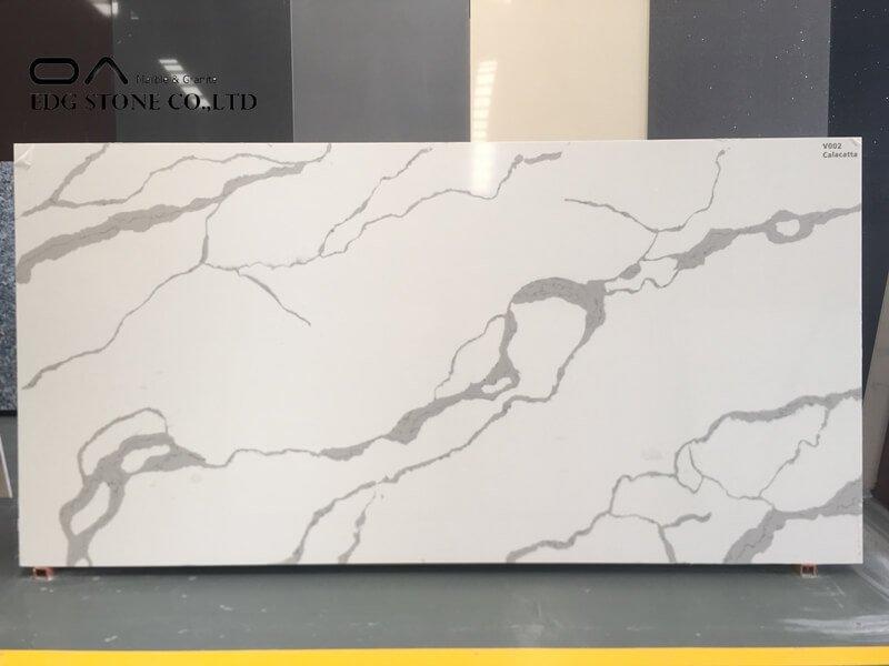 white kitchen with calacatta quartz