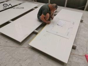 quartz countertops with oak cabinets
