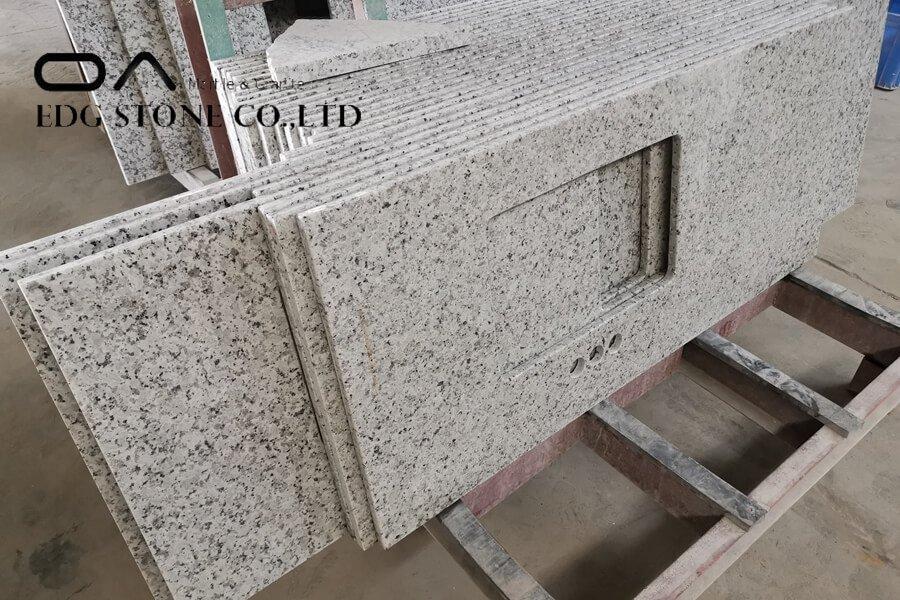 granite countertop cost per sq ft